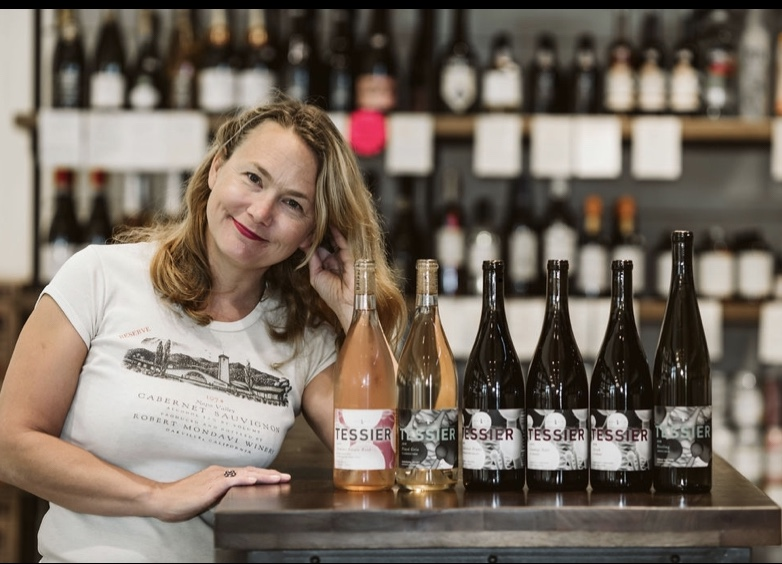 Kristie Tacey displaying wines from Tessier Winery